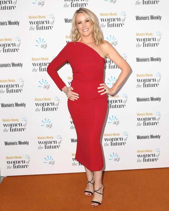Leila McKinnon wows on the red carpet in a red, one-shoulder dress.
