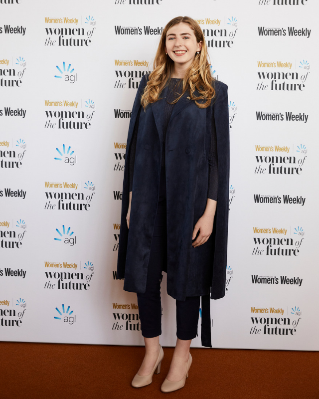 Georgie Stone from *Neighbours* looks regal in dark navy.