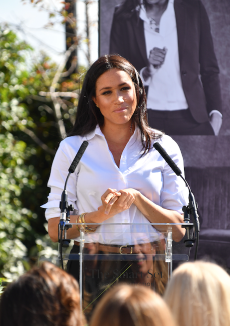 The crowd cheered when Meghan revealed she'd just found out the tote bag had already sold out online! *(Image: Getty)*