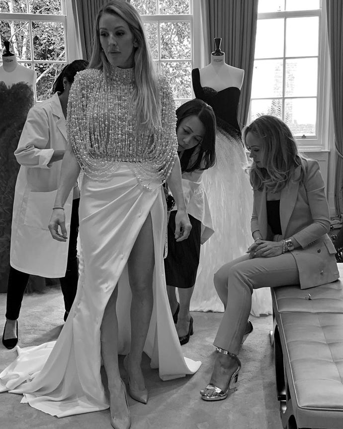 Ellie shared this snap of her being fitted into the Ralph and Russo dress.