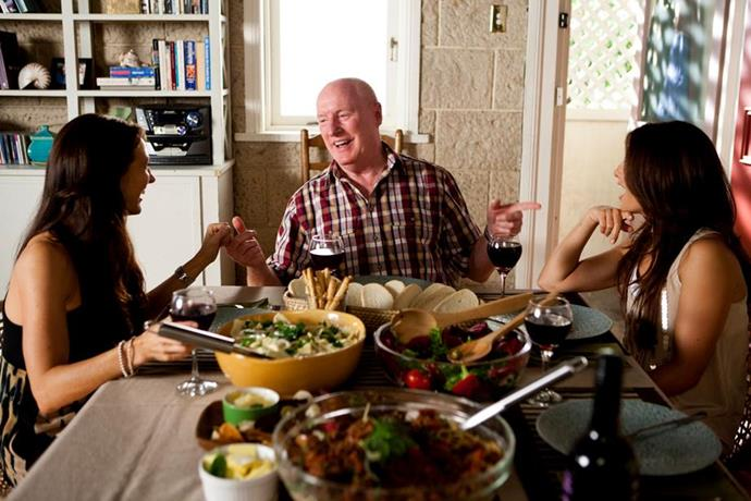 Ray on the set of *Home and Away* with Georgie Parker and Ada Nicodemou.
