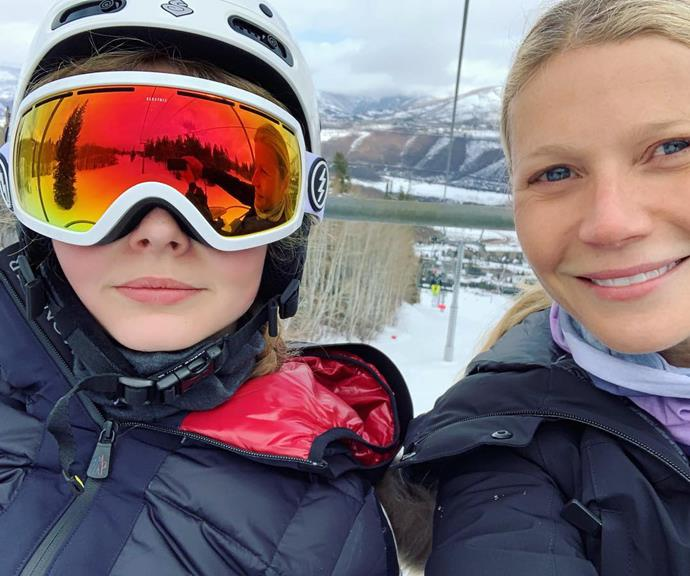 Gwyneth and Apple skiing together.