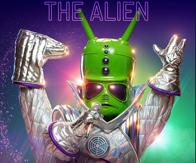 "**The Alien** <br> * ""People think I appeared out of nowhere."" <br> * ""I trained for years to achieve my dream."" <br> * ""I arrived in a stunning flash of light's and sound. It felt like the world's eyes were truly on me."" <br> * ""For a time, I truly loved the attention.""  <br> * ""I came in peace, only wanted to please, but suddenly I was the one being probed."" <br> * ""It was too much for a young Alien to bare so I beamed myself away."" <br> * Five hula hoops in the background, Spice Girls pic. <br> * ""When you pursue your dreams, success will follow and a a lot of heavy metal came my way."" <br><br> **UNMASKED**: NIKKI WEBSTER"