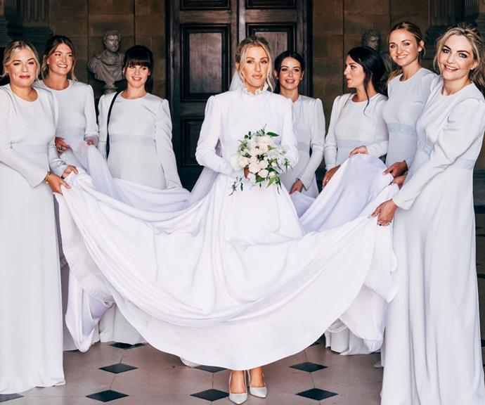 Ellie's seven bridesmaids helped her with her custom Chloe dress.