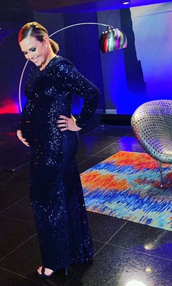 """Edwina Bartholomew announced her pregnancy on *Sunrise* in June but when she was reporting from the 2019 Emmys she shared a gorgeous bump photo in a special sparkly number. """"Praise be to @carlazampatti for creating a size 12 dress that expands to 7 months pregnant,"""" she captioned it."""