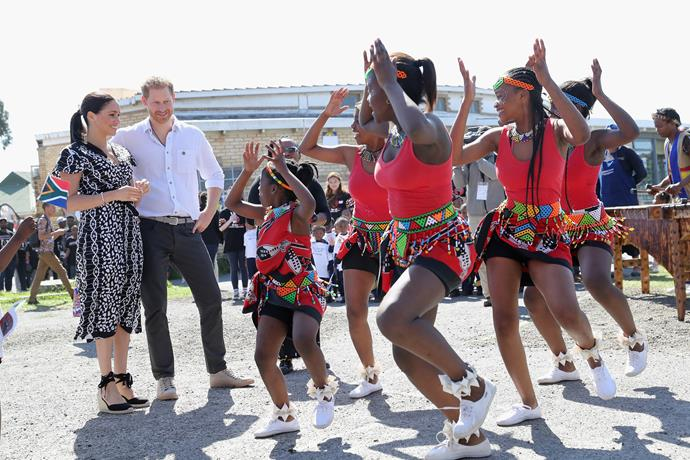 Prince Harry and Duchess Meghan joined a group of dancers in Nyanga Township.