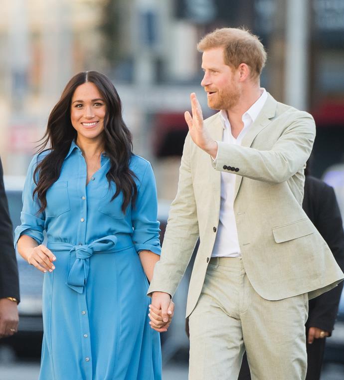 Outfit change! Meghan in her blue Veronica Beard dress.