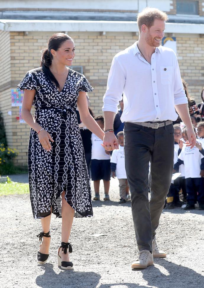 The dress was reportedly made from ethically-sourced organic cotton and stitched in the Mayamiko workshop, a charity that provides local artisans with job training.  She finished her look with Castaner wedged espadrille sandals.