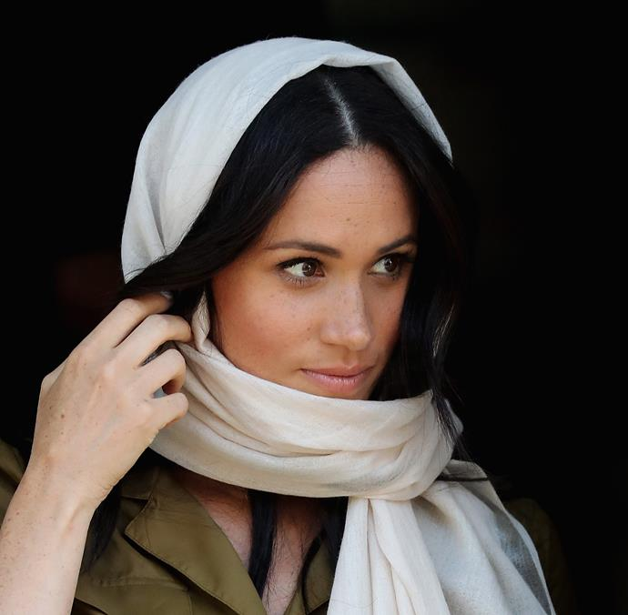 The Duchess of Sussex also donned a headscarf to enter the Islamic place of worship.