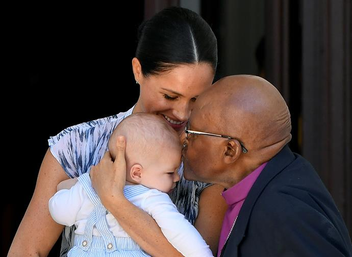 Archbishop Desmond Tutu plants a sweet kiss on Archie's forehead.