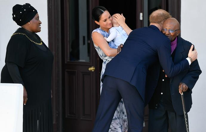 The Sussex family and the Tutu family greeted each other with warm hugs and kisses.