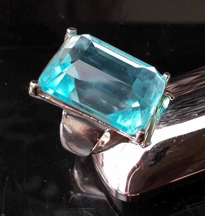 "This aquamarine cocktail ring will only set you back $21.20 on Etsy. [Buy it here.](https://www.etsy.com/au/listing/735938577/vintage-clear-blue-lucite-ring-vintage?ga_order=most_relevant&ga_search_type=all&ga_view_type=gallery&ga_search_query=blue+cocktail+ring&ref=sr_gallery-1-29|target=""_blank""