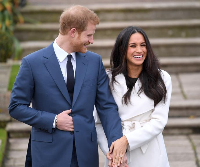 Harry and Meghan pose hand-in-hand during their official engagement photoshoot in November 2017. Too cute.