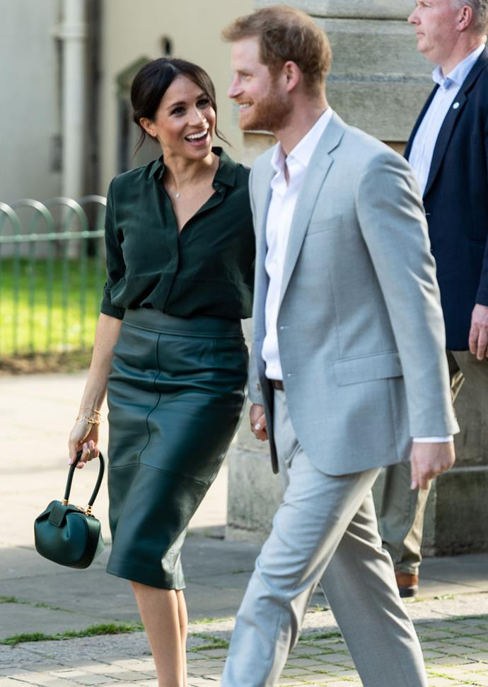 That look! Meghan looked stunning in this head-to-toe green outfit - and Harry was cleaning loving it too.