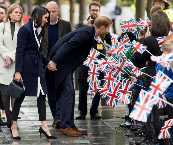 Even when they're out and about during busy official engagements, Harry and Meghan still always make sure they're physically connected and are holding hands.