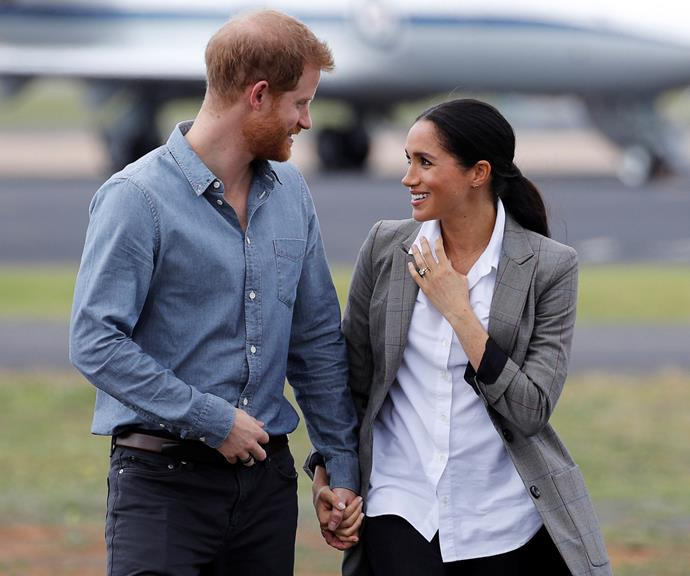 During their first overseas tour as a royal couple, Harry and Meghan only had eyes for each other. They're picture here in Dubbo, sharing a gorgeous romantic moment.