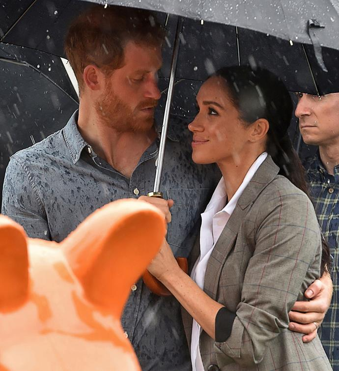 Who could forget this moment? When the heavens opened during the Duke and Duchess' trip to Dubbo, the couple sought shelter in each other's arms under an umbrella.