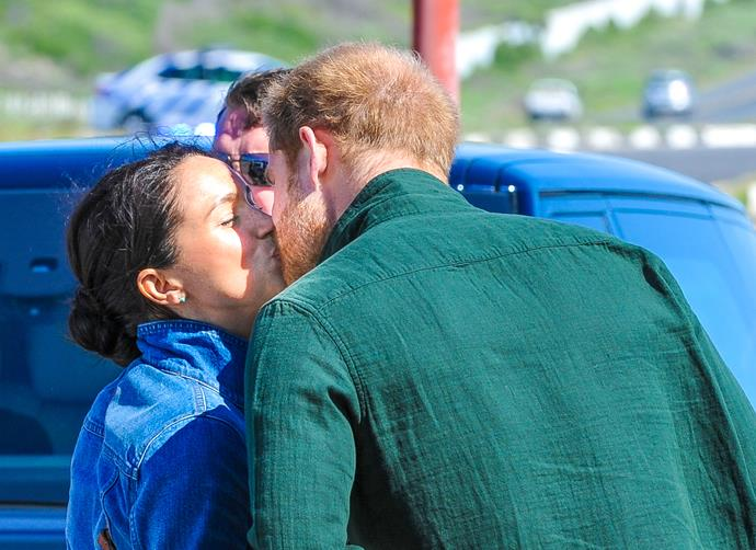 Be still our beating hearts! Harry and Meghan shared a quick smooch before parting ways on their royal tour of South Africa.