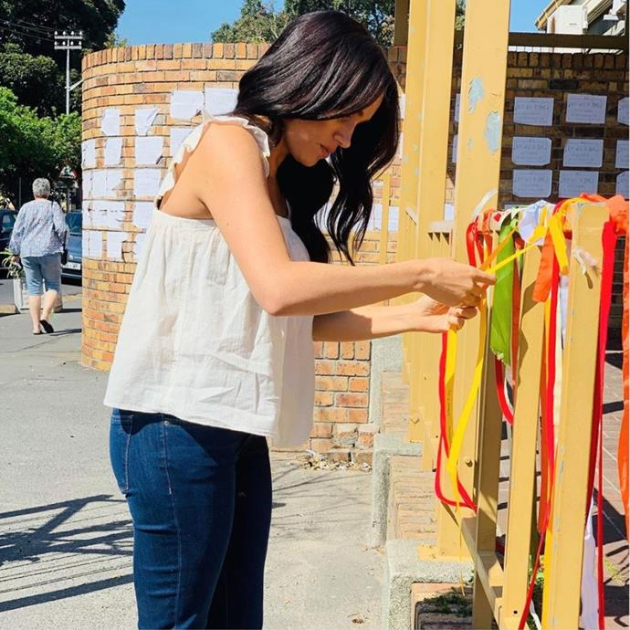 "Duchess Meghan wore a floaty white top and jeans as she made a private visit to tie a ribbon at the site where Uyinene Mrwetyana, a 19-year-old Cape Town student who was murdered last month. The action was ""to show solidarity with those who have taken a stand against gender based violence and femicide."""