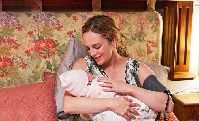 Tori cradles her newborn baby.