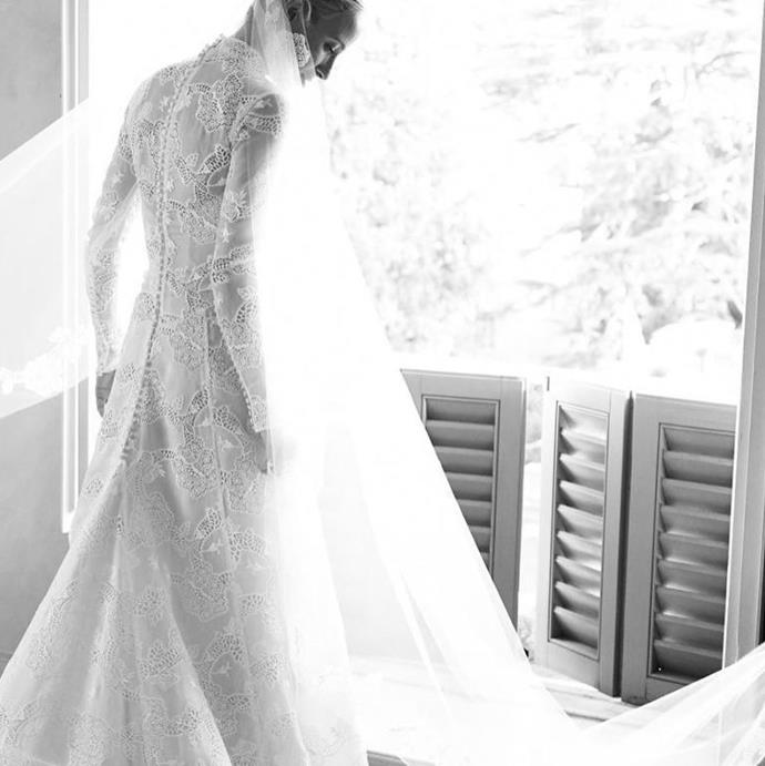 The dress was finished with a 10-metre long silk tulle veil.