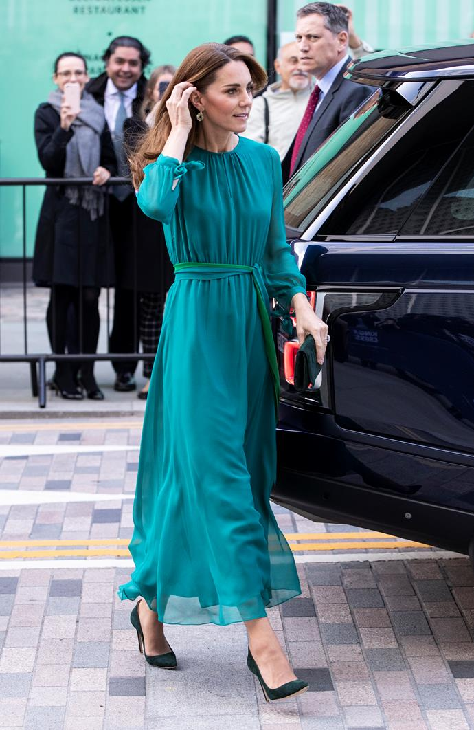 We are loving this teal look with green accessories.