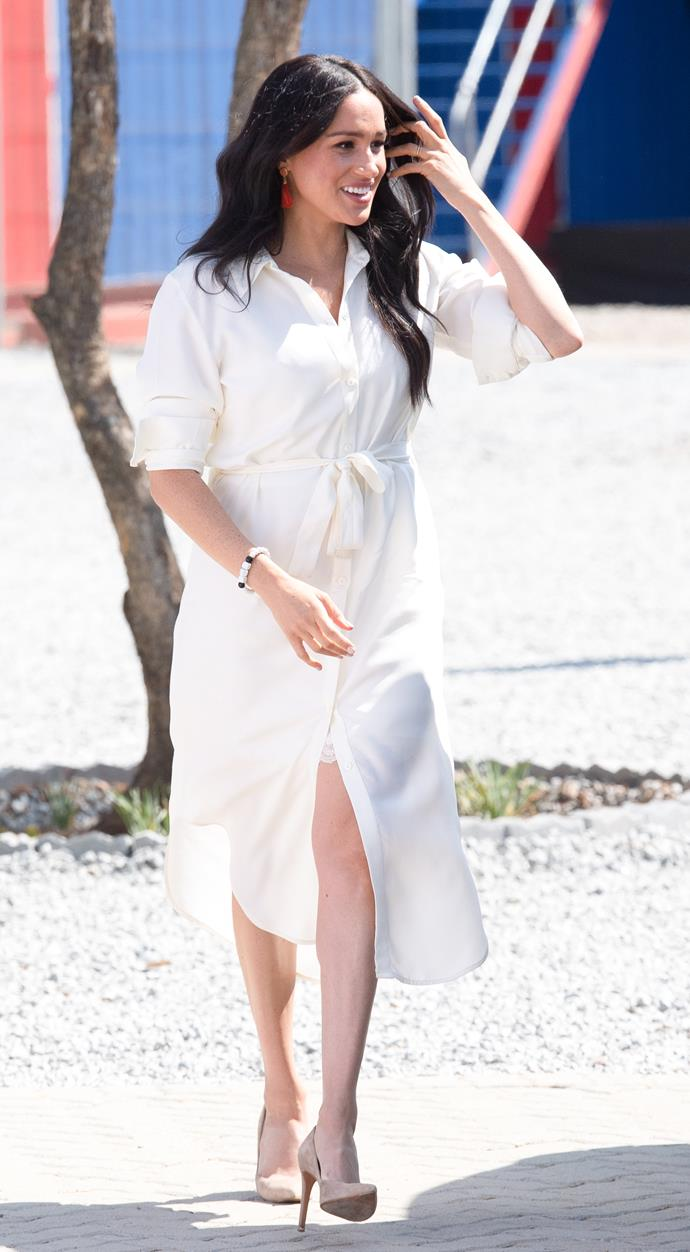 The return of the shirt dress! Duchess Meghan stepped out in the Tencel shirt dress from South African designer Hannah Lavery and accessorised her outfit with nude pumps.