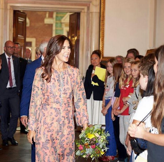 "**August 2019, Denmark**  <br><br> The future Danish queen isn't afraid to re-wear clothes though, including this [stunning orange H&M frock](https://www.nowtolove.com.au/fashion/fashion-news/princess-mary-h-and-m-dress-57896|target=""_blank"")."