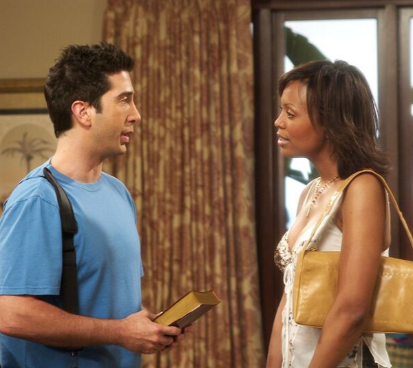 David Schwimmer and Aisha Taylor on the set of *FRIENDS*.