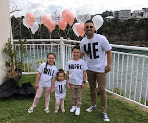 "How cute is this? The kids' t-shirts spelled out ""Will you marry me?"""