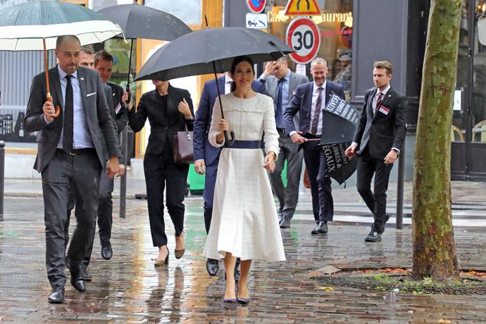 A little rain didn't stop Mary (and her entourage) from getting things done in style.