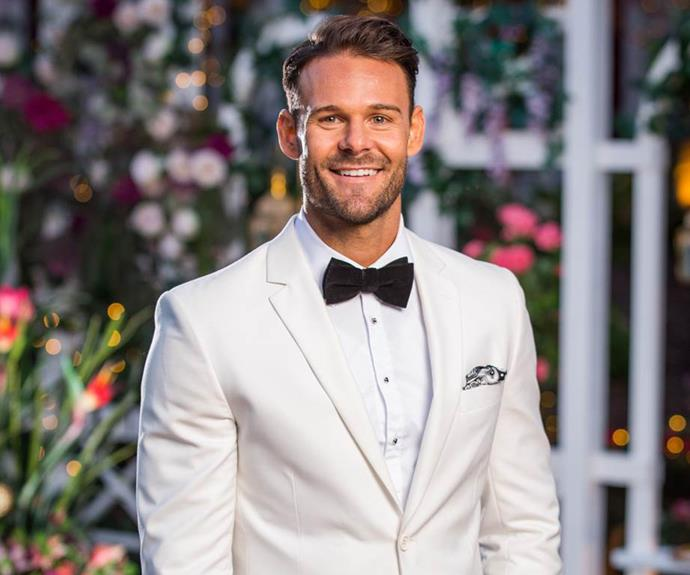 Carlin stuns Angie in a white suit on the premiere episode on *The Bachelorette*.