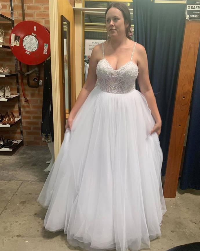 Tenille in her local op shop trying on her $100 wedding dress.