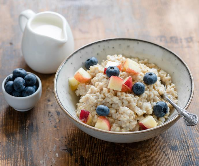 A healthy porridge topped with fruit is a great example of a breakfast loaded with healthy carbs.