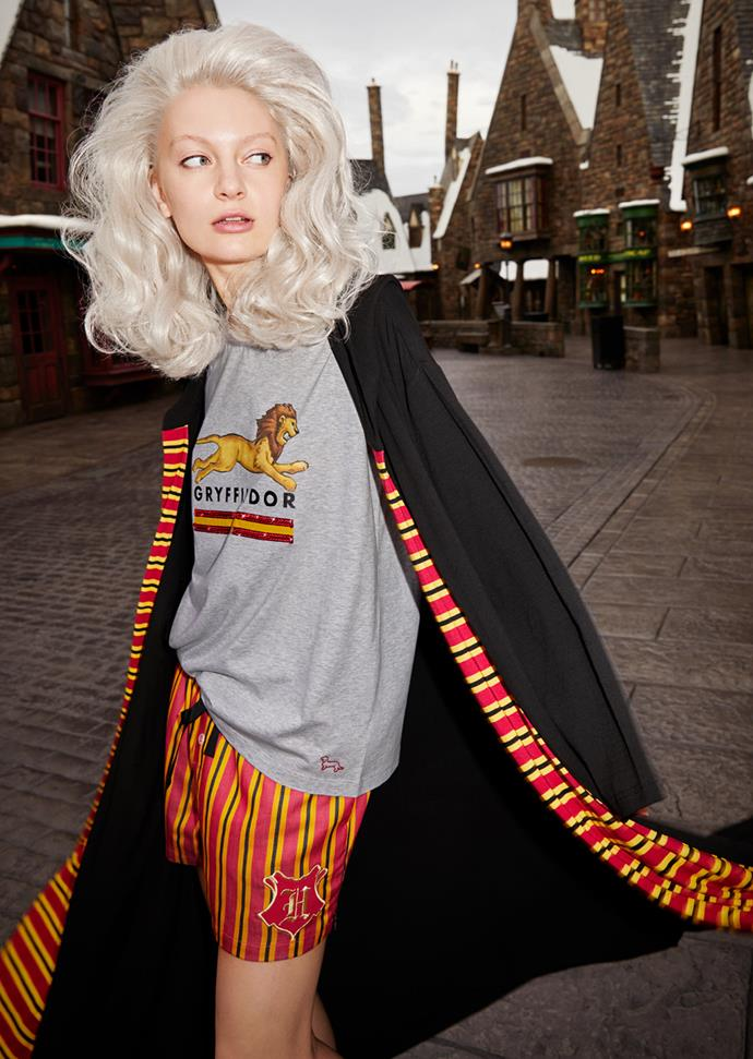 A model wears a Gryffindor T-shirt, matching shorts and Gryffindor gown.