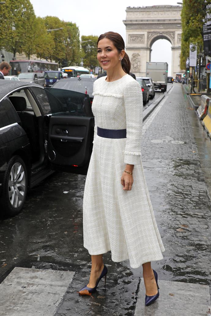 "On Day two, Mary looked elegant in this beautiful [white long-sleeved](https://www.nowtolove.com.au/women-of-the-future/the-weekly/princess-mary-paris-dresses-59667|target=""_blank"") frock."
