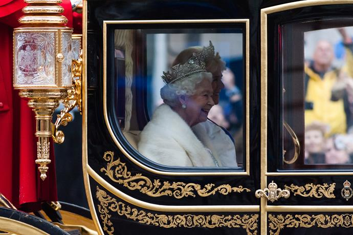 The Queen looked incredible as she travelled between Buckingham Palace and Westminster in London on Monday.