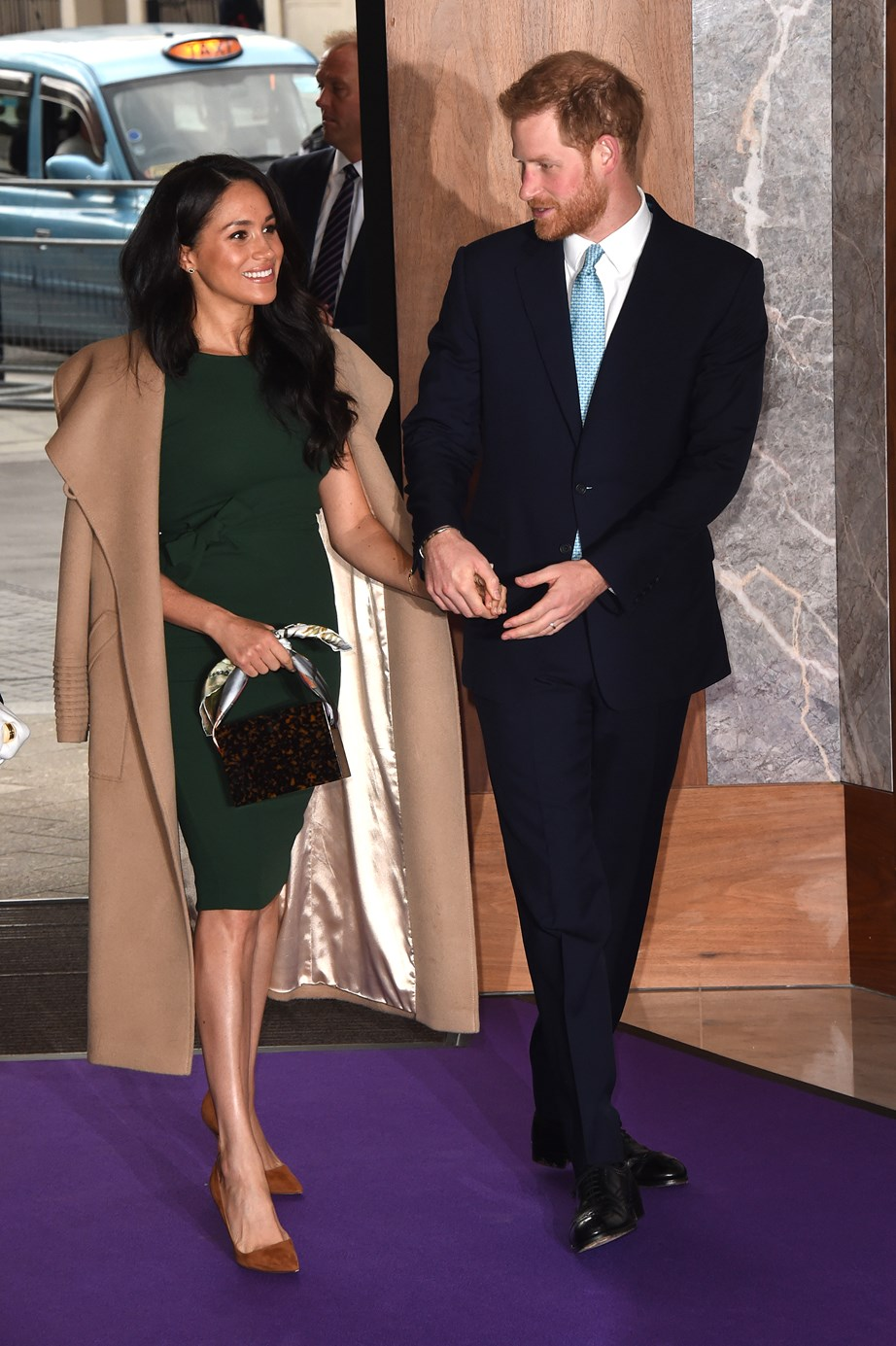 Meghan and Harry arrive hand-in-hand for the annual WellChild Awards in London. *(Image: Getty)*