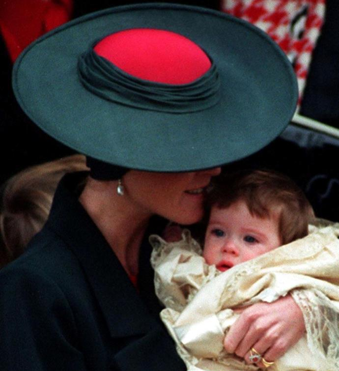 A chic-looking Fergie cradles baby Eugenie.