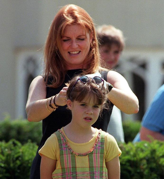 A doting Fergie adjusts Eugenie's hair.