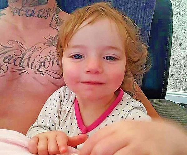 Jay got his chest tattooed with our little girl's name.