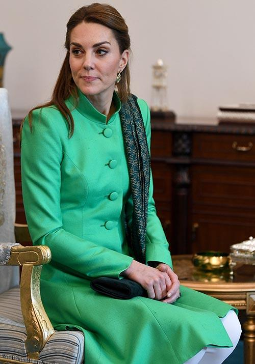 In the afternoon of day one, Kate wore a beautiful green coat designed by Catherine Walker. Again, the Duchess added a beautiful printed green scarf to the look.