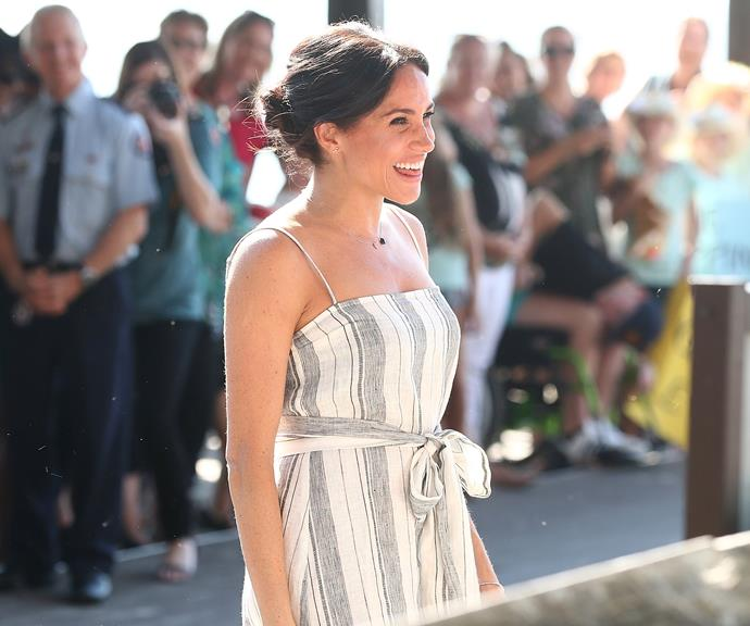 Meghan looked glowing in her pretty summer dress.