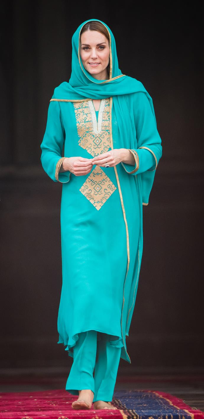 "On [day four](https://www.nowtolove.com.au/royals/british-royal-family/prince-william-kate-middleton-plane-emergency-59836|target=""_blank"") of the royal tour, Kate casually provided us with one of her most incredible outfits to date. Wearing a breathtaking teal and gold shalwar kameez, the beautiful ensemble was handmade by designer Maheen Khan, and was an off-the-rack purchase from London boutique O'nitaa."