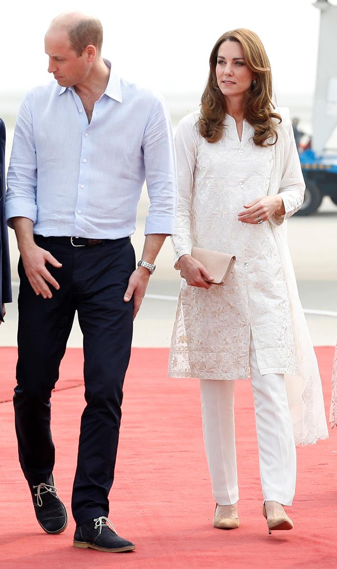 Earlier on day four, Kate and Wills touched down in Islamabad where they visited a local school and tried their hand in a cricket tournament. But before the royals got into the rough and tumble of the sport, Kate stepped out in this heavenly white ensemble. <br><br> Designed by Pakistani label Gul Ahmed, the traditional shalwar kameez featured beautifully intricate gold detailing.