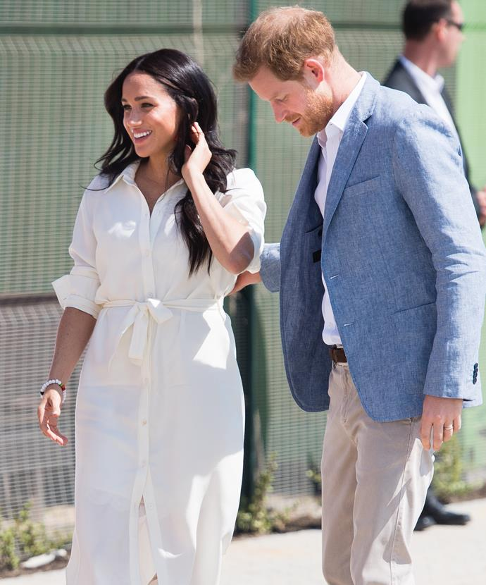 Meghan's Hannah Lavery white shirt dress was a classic and modest choice on the final day of their whirlwind royal tour of Africa.