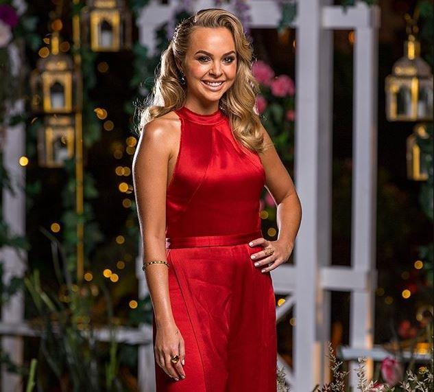 "True to form, we weren't surprised to see Angie in the [striking red hue](https://www.nowtolove.com.au/reality-tv/the-bachelorette-australia/the-bachelorette-angie-tells-off-jess-59711|target=""_blank"") synonymous with the show, and indeed those coveted roses. This high neck jumpsuit by Alexis confirmed what we well and truly already knew to be true: This gal is one helluva bombshell."