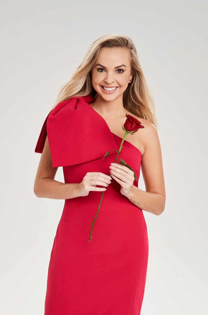 In the very first *Bachelorette* promo shoot, Angie wore a siren red one-shoulder dress that gave us the best taster of the glorious fashion spectacle that was to follow.