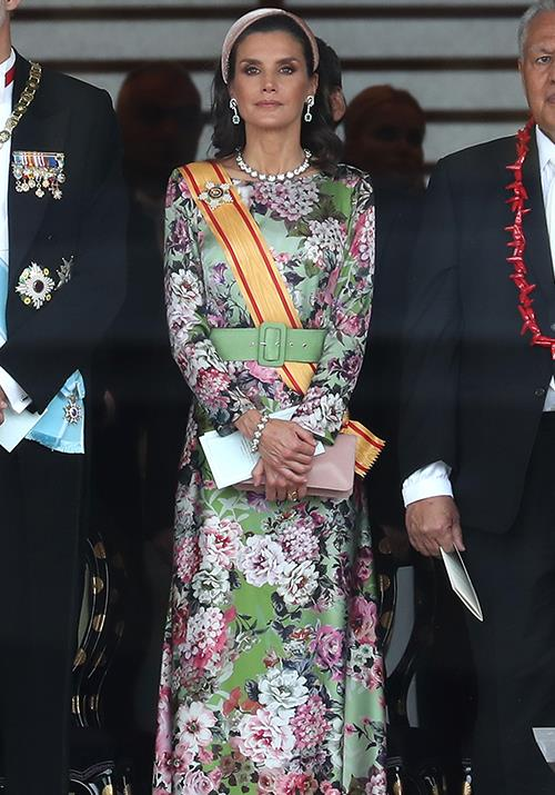 Queen Letizia turned heads in her bright floral gown.