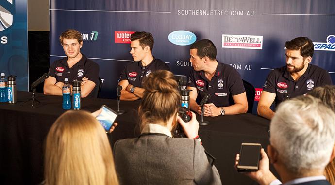 Liam 'explains' himself at a press conference.